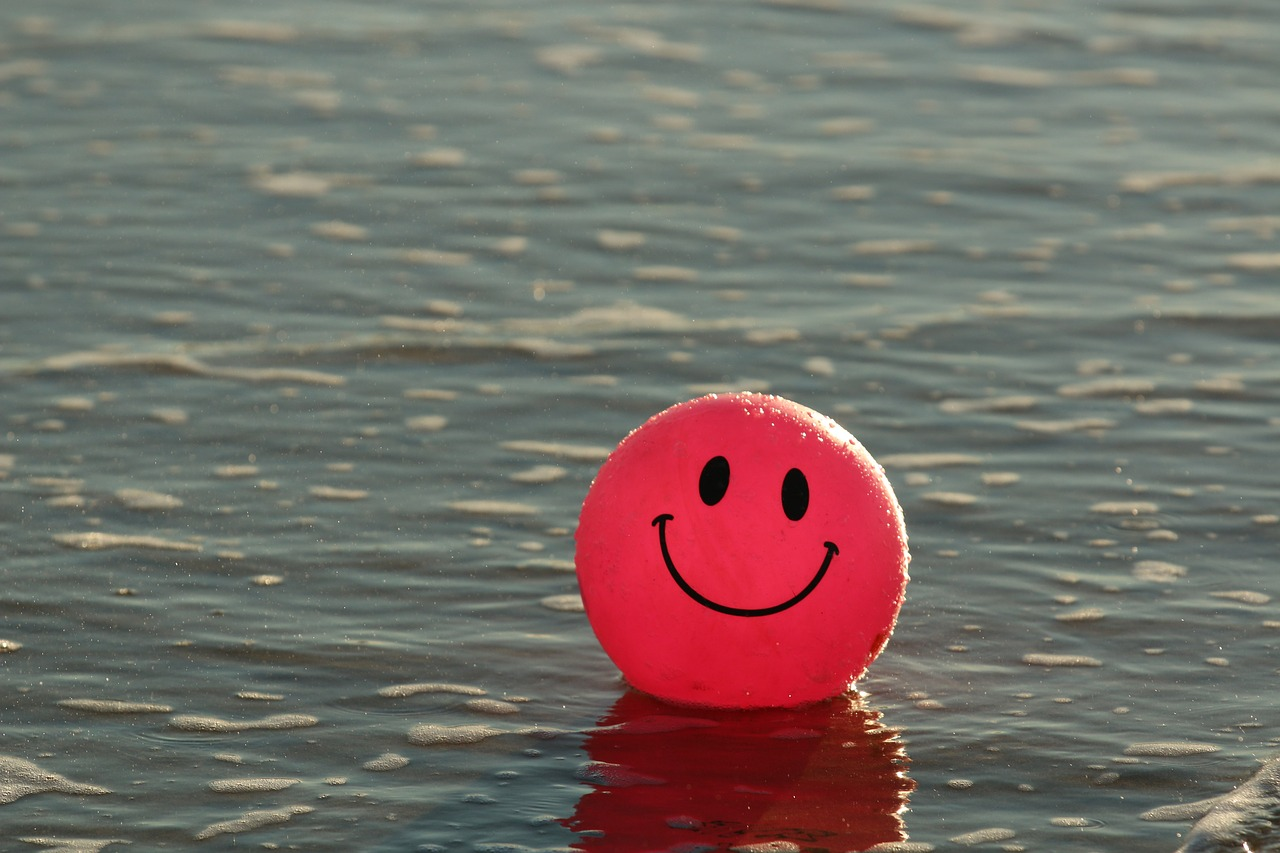 Happy Smiley Face Ball Floating on Water